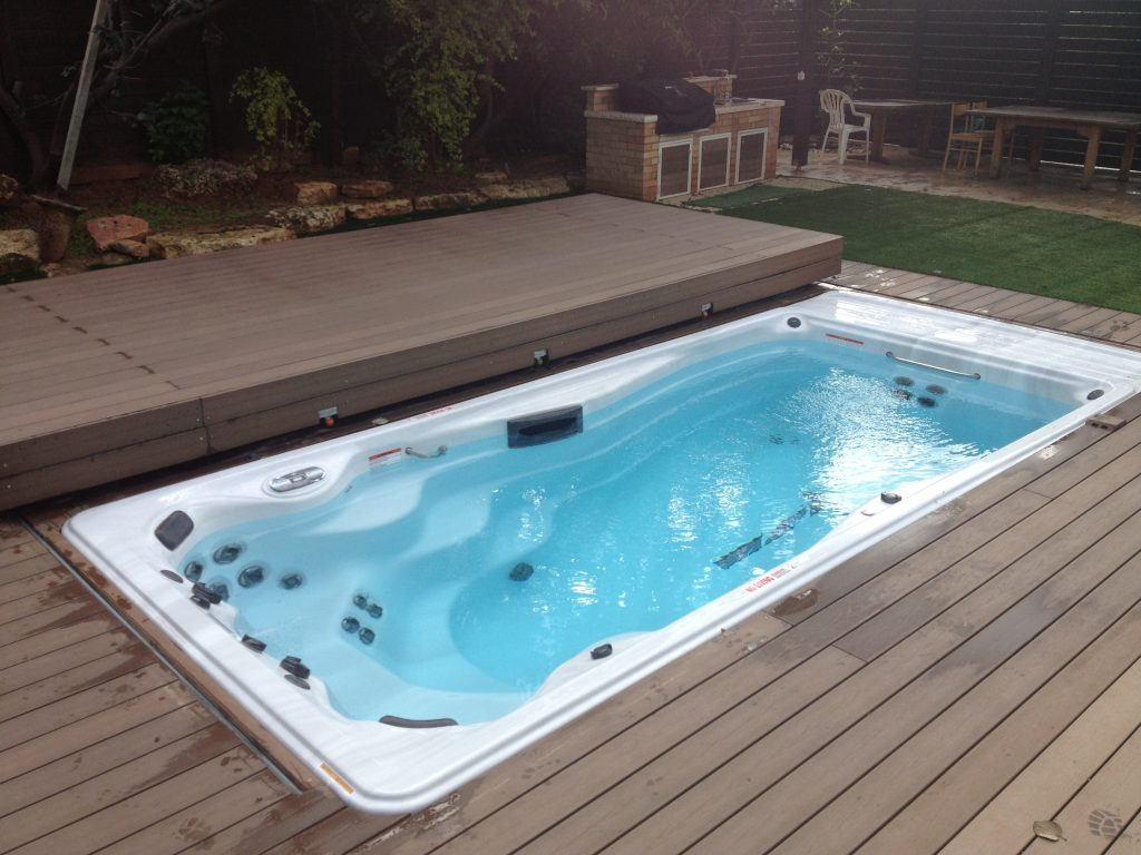 Phoenix swim spas hot tubs swim spa international for Swimming spa